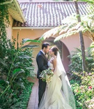 bride and groom portrait at hotel bel-air bride in oscar de la renta strapless ruffle gown