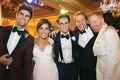 jesse tyler ferguson and justin mikita with bride, groom, and father of the bride