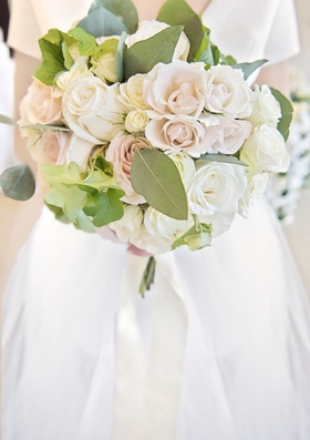 bridal bouquet with ivory and blush roses and large eucalyptus leaves