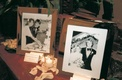 Table displayed black and white family wedding photos