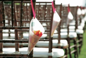 Confetti cones on ceremony chairs to toss
