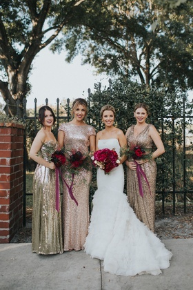 bride in liancarlo ruffled trumpet gown, bridesmaids in mismatched gold and rose gold sequins