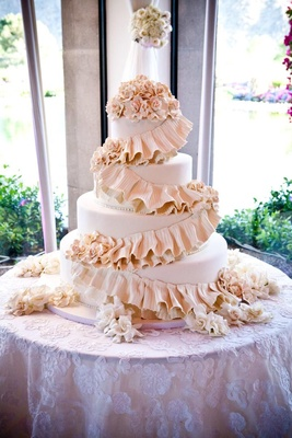 Four layer wedding cake with pink sugar flowers
