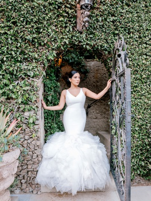 bride in ines di santo wedding dress, v-neck fit-and-flare gown with full ruffles
