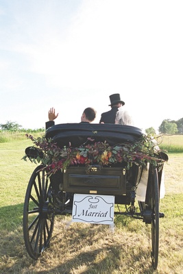 Bride and groom exit ceremony in vintage transport