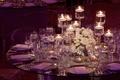 Low centerpiece arrangement on glass reception table