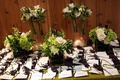 Escort cards on table with natural flower arrangements