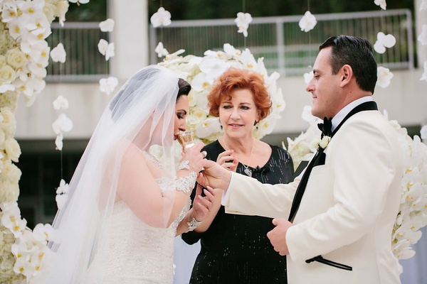 groom offers sip of wine to bride for a wine unity ceremony