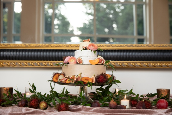 wedding trend cake made from wheels of cheese paired with tropical fruits