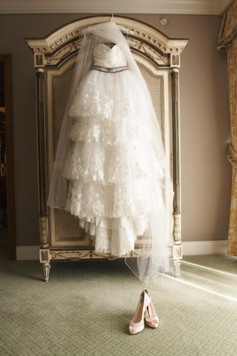 Hanging wedding dress in bridal suite
