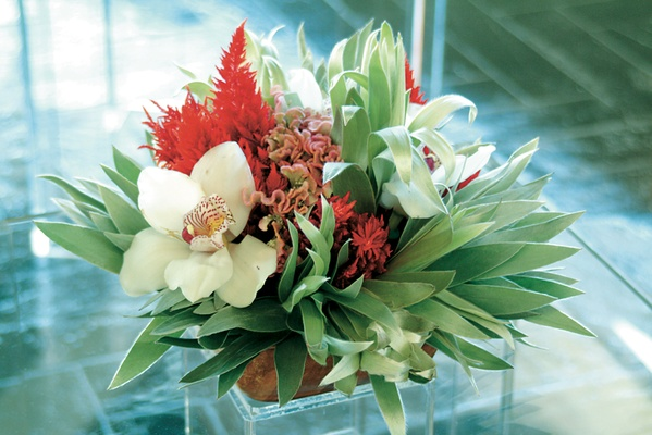 Palm fronds, coxcomb, saffron, and orchids