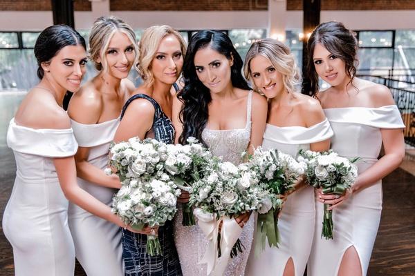 bride in sparkling wedding dress bridesmaids in off shoulder white dresses high slits moh in blue