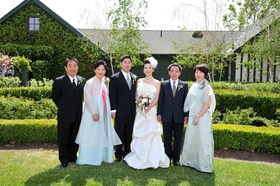 Asian wedding family guests in front of home