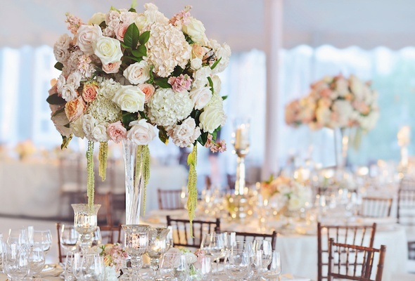 Tent wedding centerpiece with white hydrangea, pink and orange flowers, amaranthus