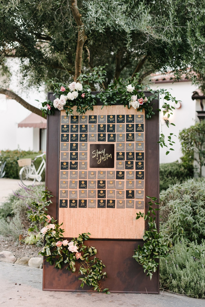 wooden seating chart display with gold wax seals