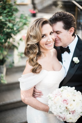 bride with soft waves in monique lhuillier dress and added off-the-shoulder sleeves