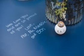 engagement ring balanced on monogrammed ping pong ball