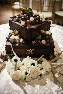 Groom's cake with letter k initial monogram brown frosting chocolate covered strawberries on top