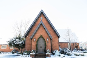 brick church with steeple, snow-covered church winter wedding