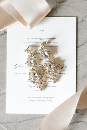 gold chandelier earrings with emerald cut diamonds
