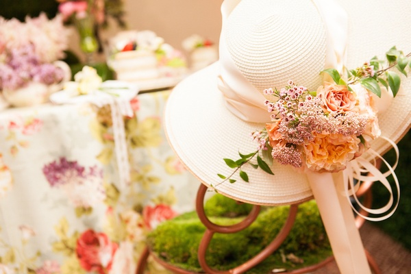 Tea party white hat with white ribbon and fresh flowers