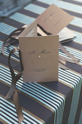 Tan booklets tied with brown ribbon