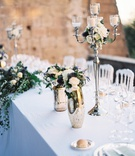 outdoor destination wedding silver candelabra mercury glass vase thistle white rose dahlia flowers