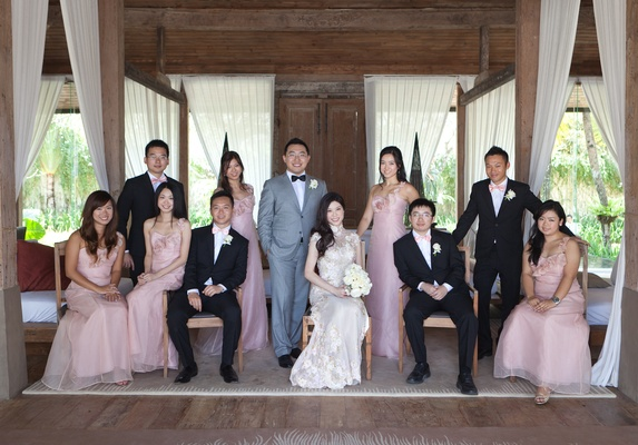 Asian bride and groom with bridesmaids and groomsmen