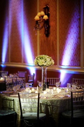 White centerpiece at ballroom reception with purple lighting