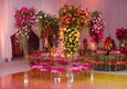 wedding reception pink velvet cushion with yellow orange pink flowers lucite arch arbor ballroom