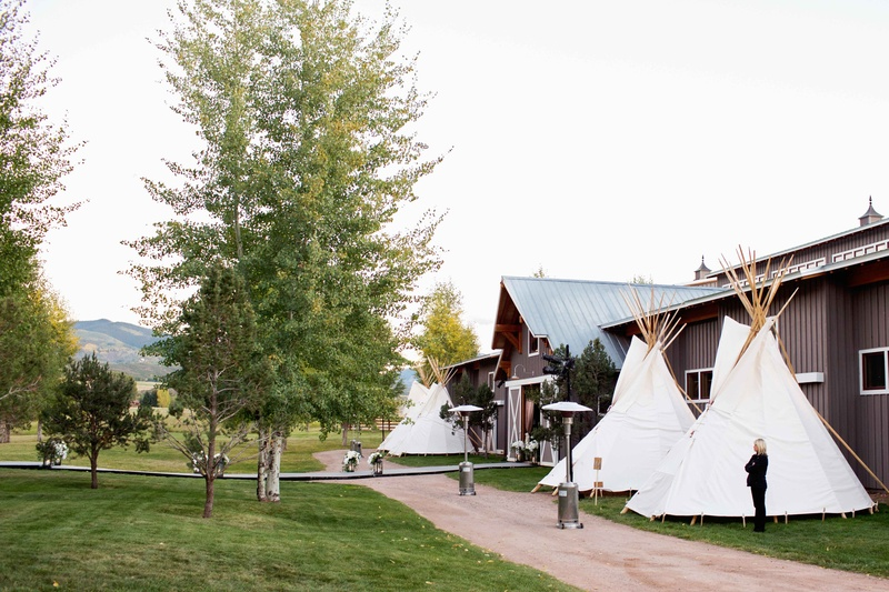 Ranch wedding barn reception with outdoor teepee tipi bathrooms with full services and luxe decor