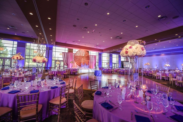 Traditional indian wedding with a vibrant summer color palette purple and blue reception uplighting junglespirit Gallery