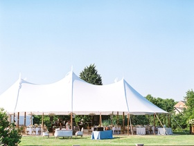 Wedding reception venue grass lawn at inn in maryland outside washington dc tent reception white