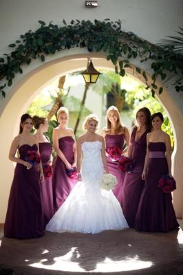 Bride with bridesmaids in purple dresses