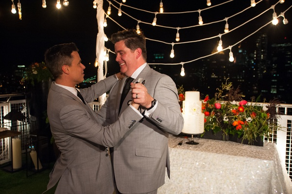 Gay grooms dance on New York City rooftop