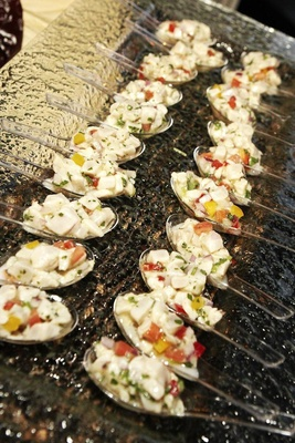 Clear spoons filled with halibut ceviche
