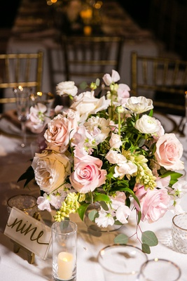 wedding reception low centerpiece pink white garden rose ranunculus greenery acrylic table number
