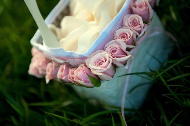 White flower girl basket with pink rose border