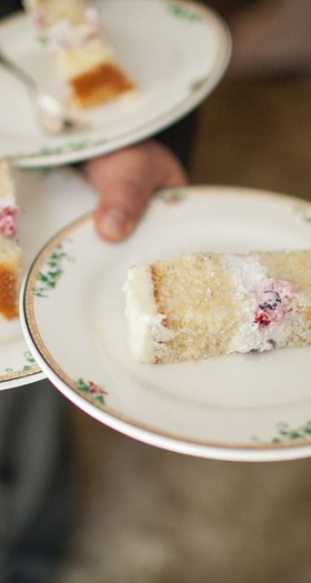 Slices of cake from Joanie & Leigh's Cakes at bridal shower on small china plates