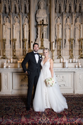 bride and groom portrait at catholic church wedding ceremony chicago lace gown overskirt