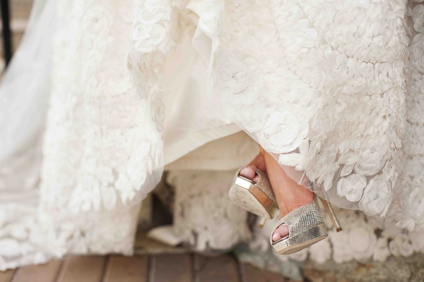 Lace wedding dress and metallic Jimmy Choo heels