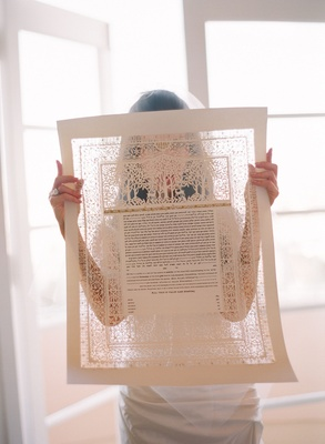 Bride examines her ketubah