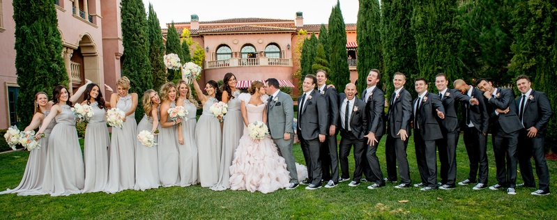 f850115b2c52 Bride in ruffle Mark Zunino wedding dress with bridesmaids in grey and  groomsmen in Converse
