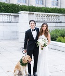 wedding photo of bride and groom with golden retriever wearing collar of greenery chicago wedding