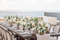 wedding reception centerpiece outdoor vase candle lisianthus rose foliage french chair oval back
