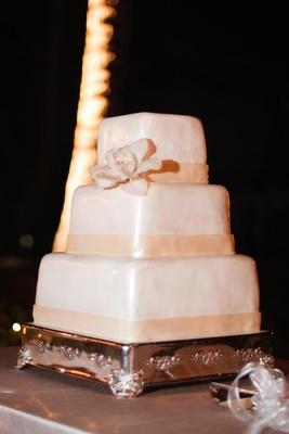 White and ivory square cake with magnolia