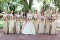 Bride in trumpet gown with bridesmaids eight in gold sequin dresses colorful bouquets