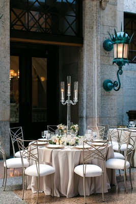 crystal candelabra with three candles, neutral linens, chameleon chairs