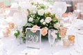 wedding reception table number on acrylic glass panel block crystal candleholder glass votives peach
