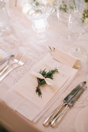 Wedding place setting antique lace linen with white napkin herb white bow ribbon menu card